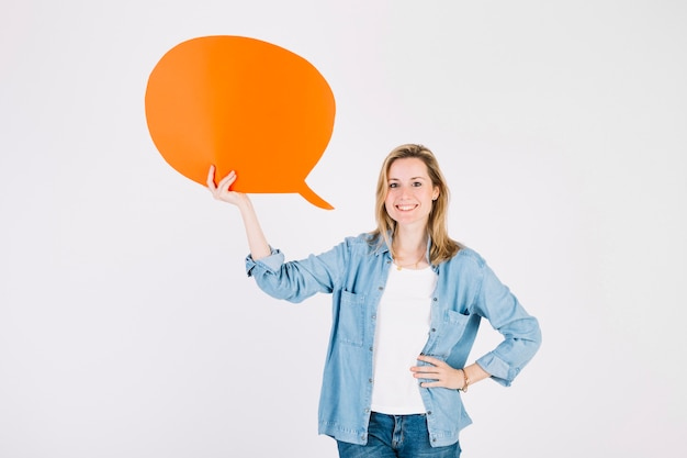 Young woman with orange speech bubble Premium Photo