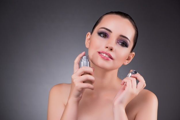 Young woman with perfume in beauty Premium Photo