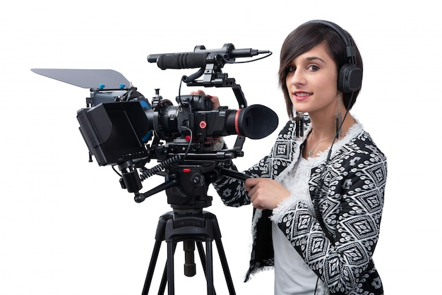 Young woman with professional video camera, dslr, on white Premium Photo