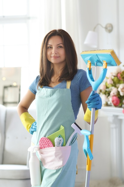 Young woman with rubber gloves, ready to clean Free Photo