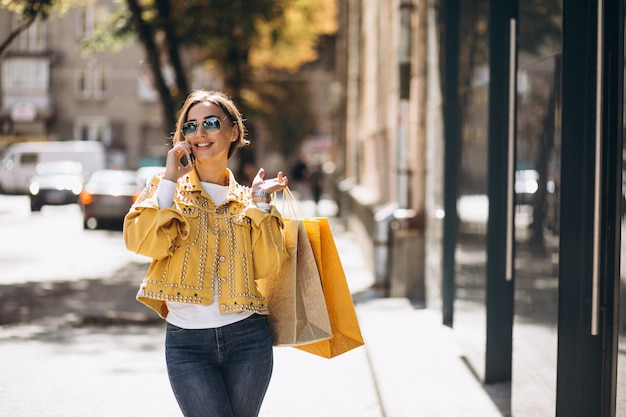 Young woman with shopping bags in the city Free Photo