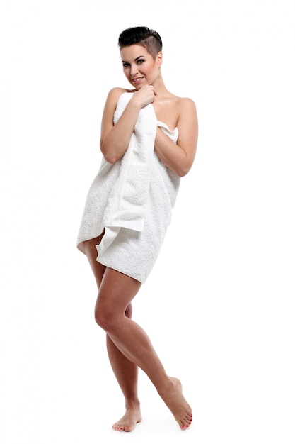 Young woman with short haircut in towel Free Photo