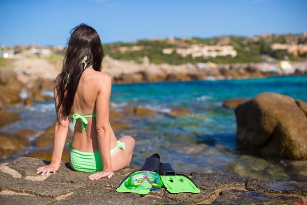 Young woman with snorkeling equipment on big stones Premium Photo
