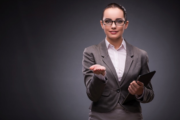 Young woman with tablet in business Premium Photo