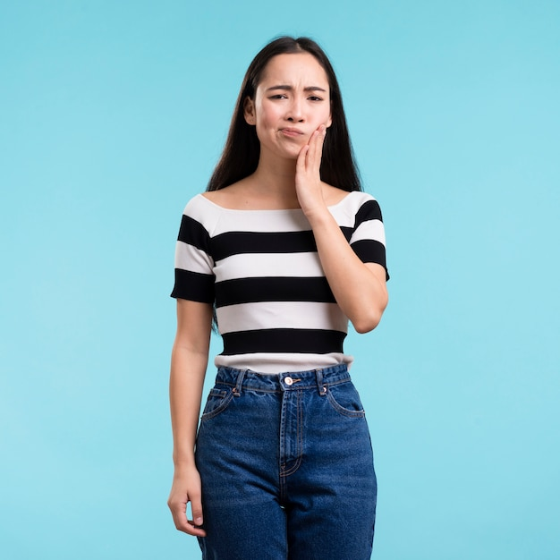 Young woman with tooth pain Free Photo