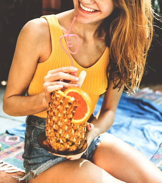 Young woman with a tropical pineapple Premium Photo