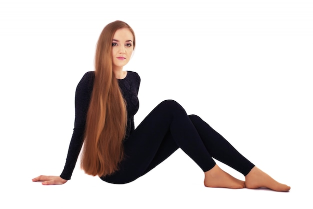 A young woman with very long straight hair. Premium Photo