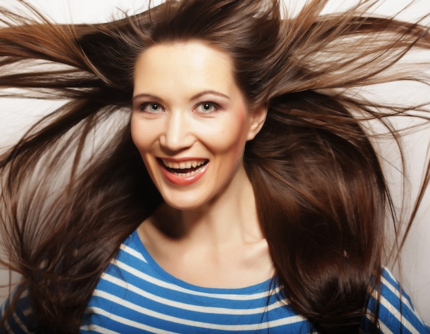 Young  woman with wind in hair Premium Photo