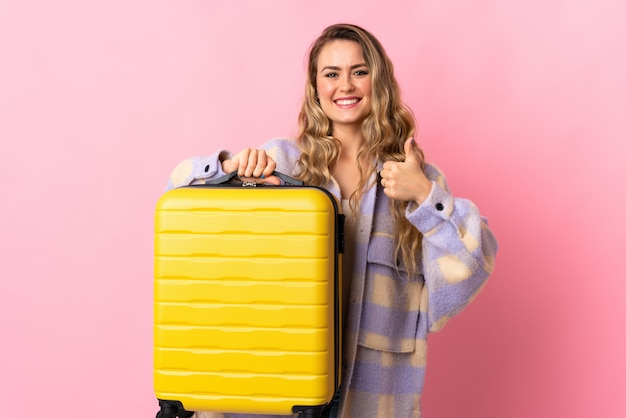 Young woman with yellow travel suitcase Premium Photo