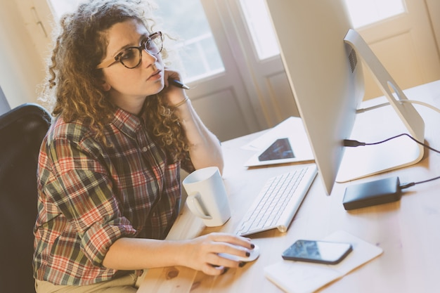 Young woman working at home or in a small office Premium Photo