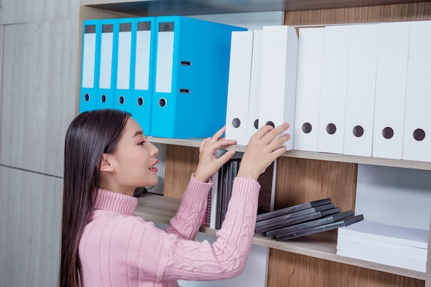 Young woman working office. Free Photo