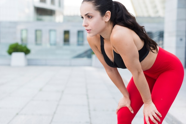 Young woman working out at the street Free Photo