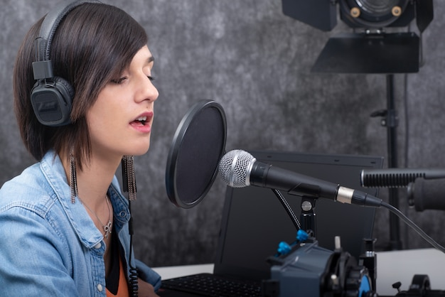 Young woman working on the radio Premium Photo