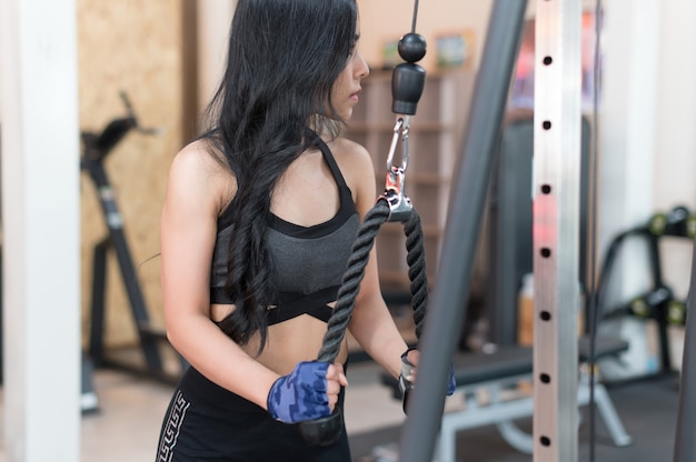 Young woman workout in gym healthy lifestyle Premium Photo