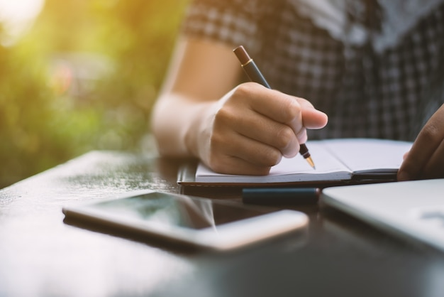 Young Woman Writing On A Notebook Photo Free Download