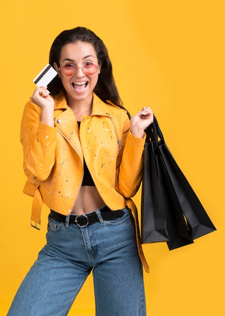 Young woman in yellow leather jacket black friday sale Free Photo