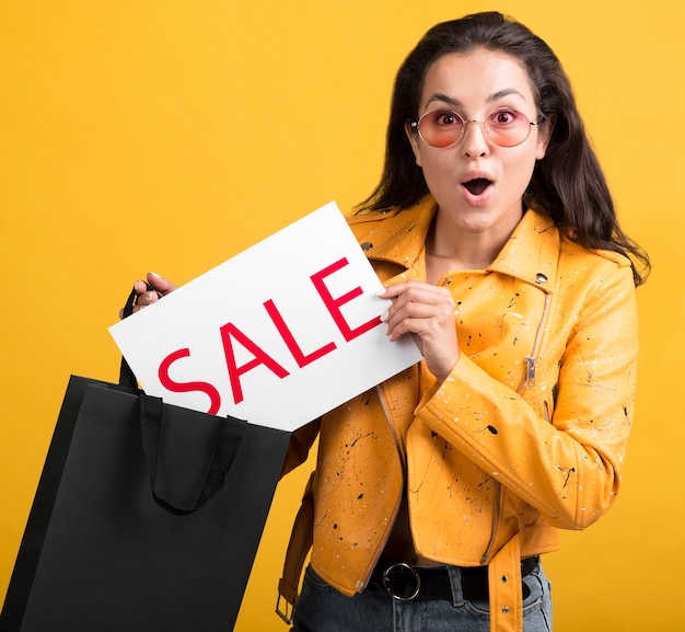 Young woman in yellow leather jacket sales banner Free Photo