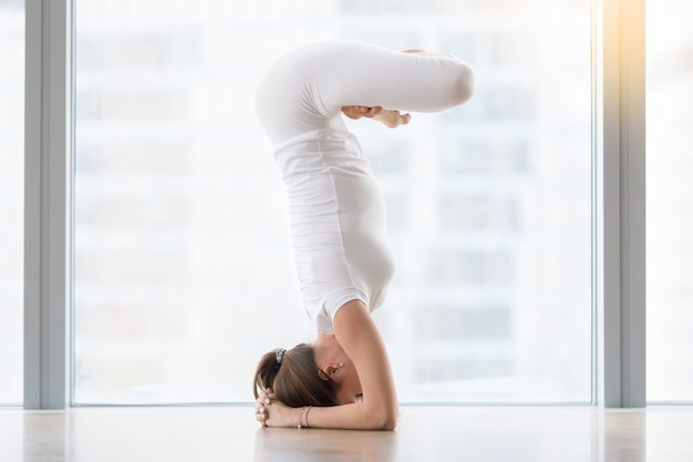 Young woman in yoga pose Free Photo