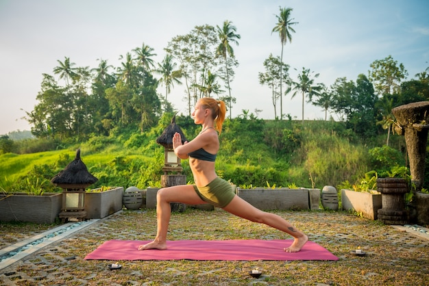 Young woman yoga stretching Free Photo