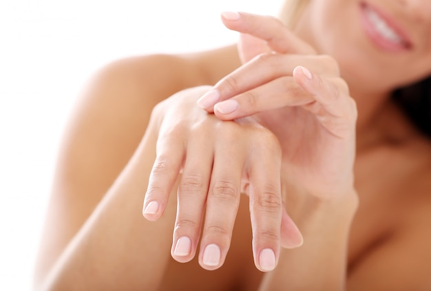 Young womans hands, nail manicure Free Photo