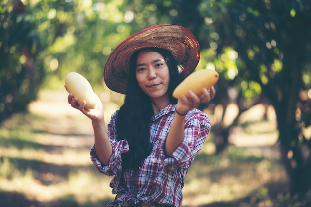 Young women farmer, mango farm Premium Photo