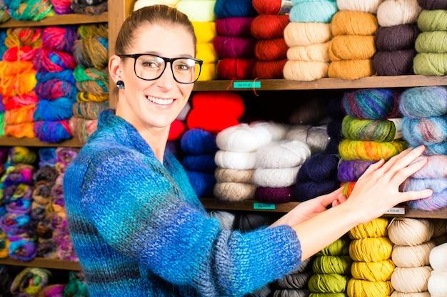 Young women in knitting shop Premium Photo