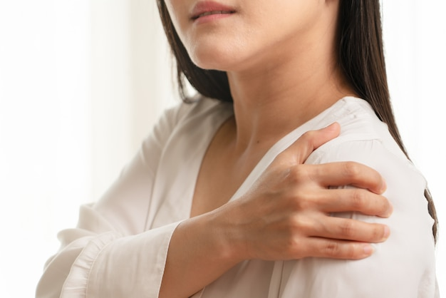 Young women neck and shoulder pain injury, healthcare and medical concept Premium Photo