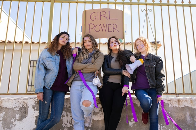 Young women protesting together Free Photo