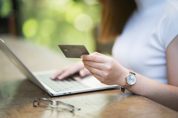 Young women using laptop and credit card shopping online, e-commerce concept Premium Photo