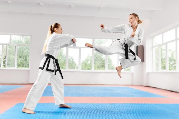 Young women wearing in kimono and black belt training karate martial arts. Premium Photo