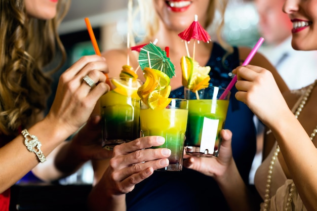 Young women with cocktails in bar or club Premium Photo
