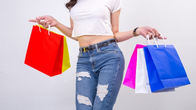 Young women with shopping on white Premium Photo