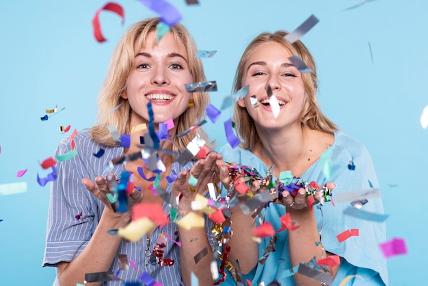 Young womens having fun with confetti Free Photo