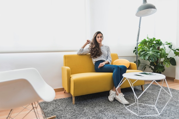 Young worker sitting on the couch Free Photo