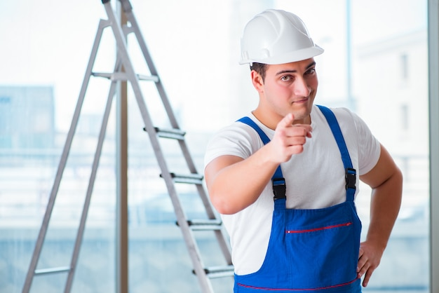 Young worker with safety helmet hardhat Premium Photo