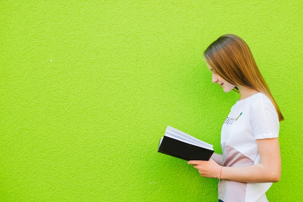Youngster reading book Free Photo