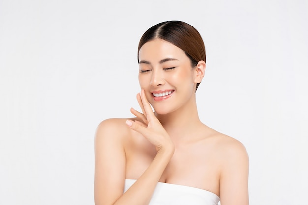 Youthful bright skin pretty asian woman with hand touching face and eyes closing Premium Photo