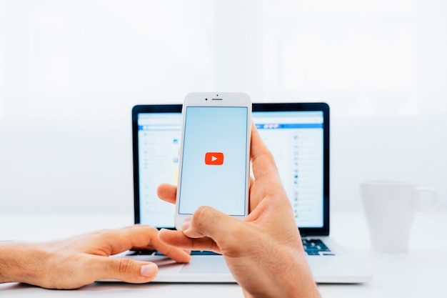 Youtube on the phone and facebook on the laptop Premium Photo