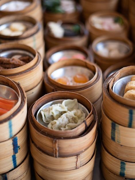 Yumcha, dim sum in bamboo steamer, chinese cuisine Premium Photo