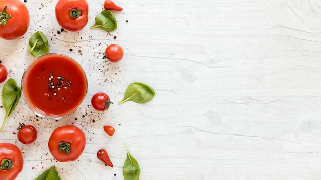 Yummy tasty tomato with spices and spinach on white table Free Photo