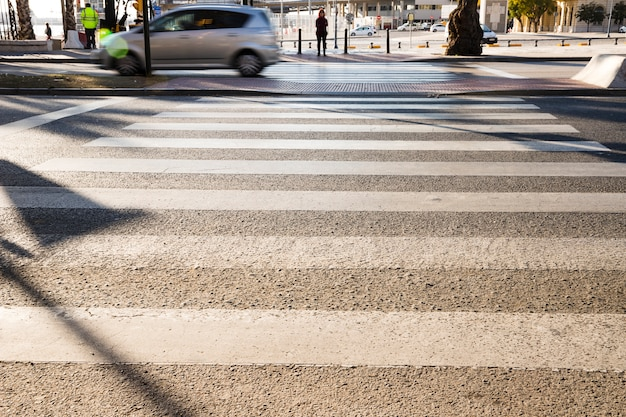 Zebra crosswalk on the road for safety Free Photo