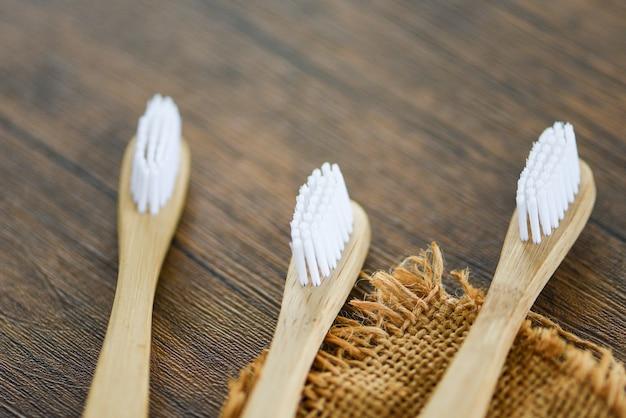 Zero waste bathroom use less plastic concept / bamboo toothbrush on the sack eco natural plastic free items Premium Photo