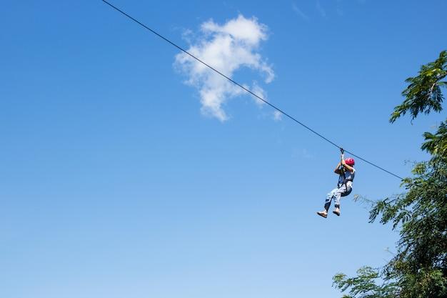 Zip line extreme sport rides Premium Photo