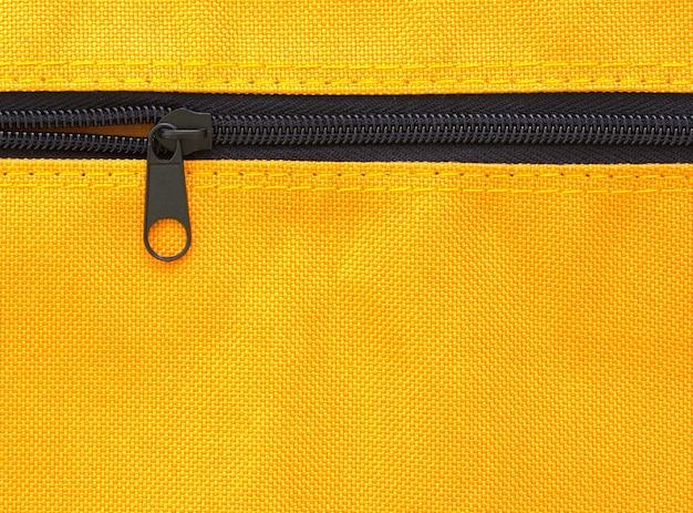 Zipper on yellow bag background Free Photo