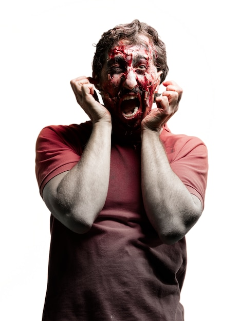 Zombie clawing face Free Photo