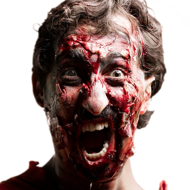 Zombie face screaming Free Photo