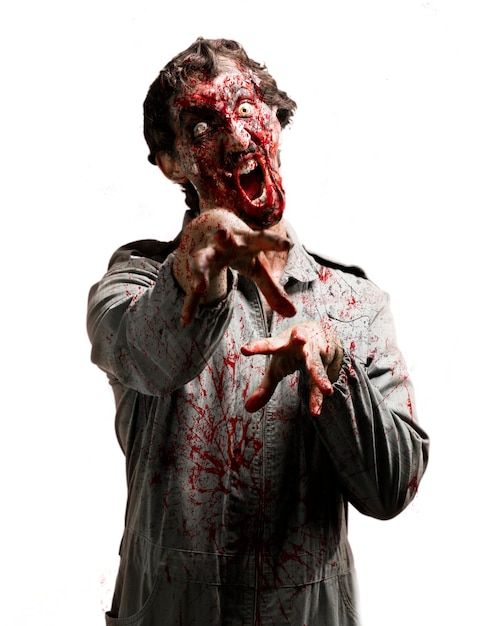 Zombie with jaw inhinged Free Photo