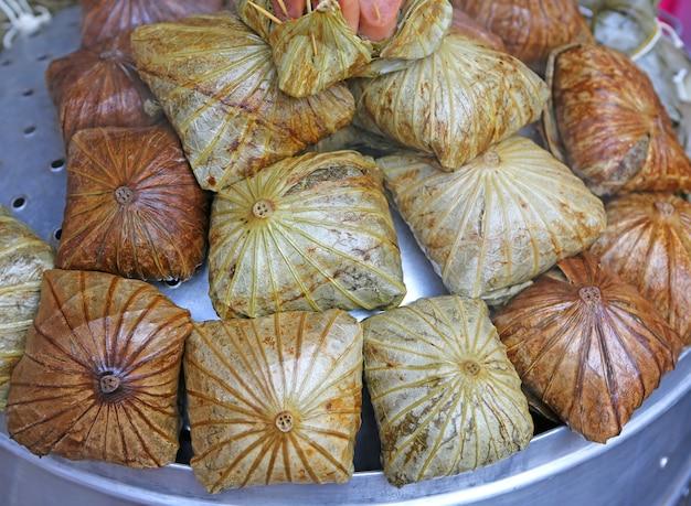 Zongzi , chinese rice dumplings in lotus leaf. Premium Photo