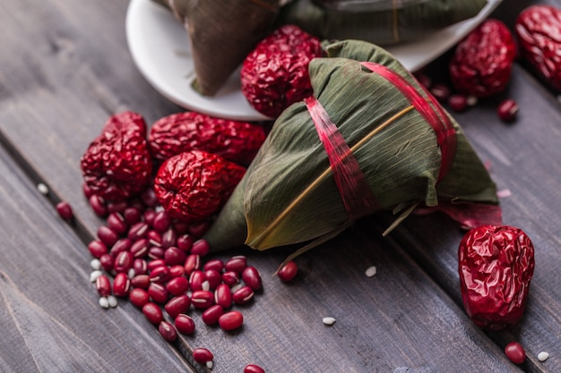 Zongzi covered with red fruits Free Photo