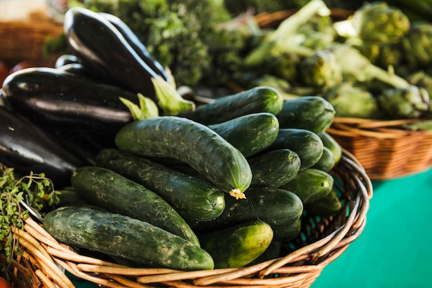 Zucchini and eggplant in wicker basket for sale in supermarket Free Photo